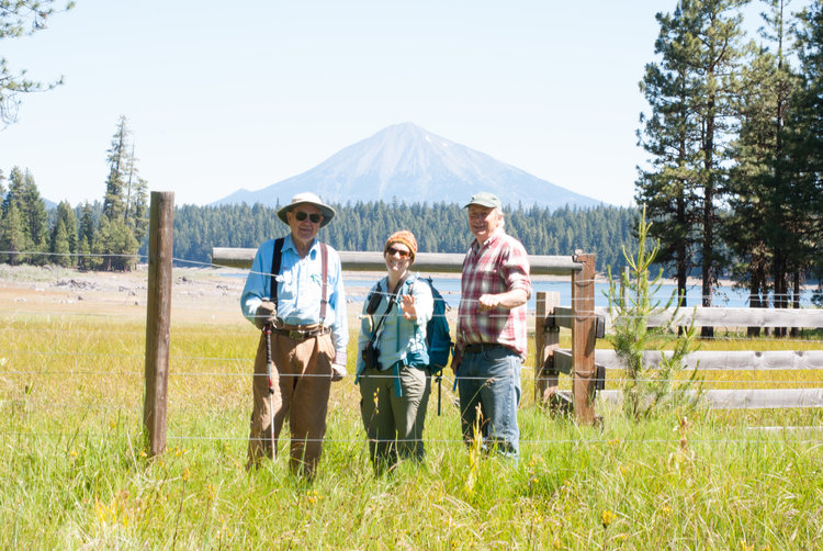 Landowner Jud Parsons, SOLC's Karen Hussey, and forester Marty Main pictured with Mt. McLoughlin in the background.